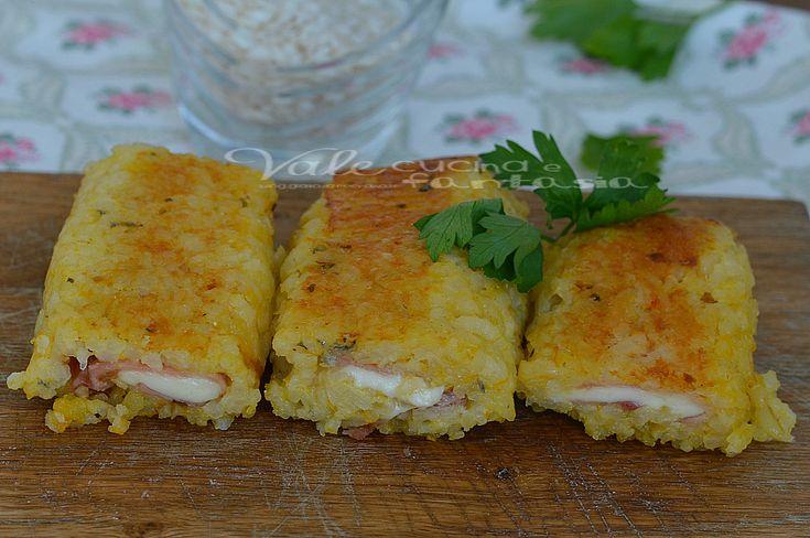 Rotolini di riso con prosciutto cotto e formaggio , buoni e sfiziosi,un modo goloso per utilizzare il risotto che avanza, filanti e gustosi,ideali per tutti