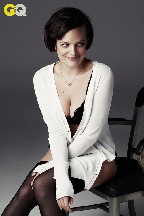 Office crush! Mad Men's Elisabeth Moss strips down to her bra and knickers for…