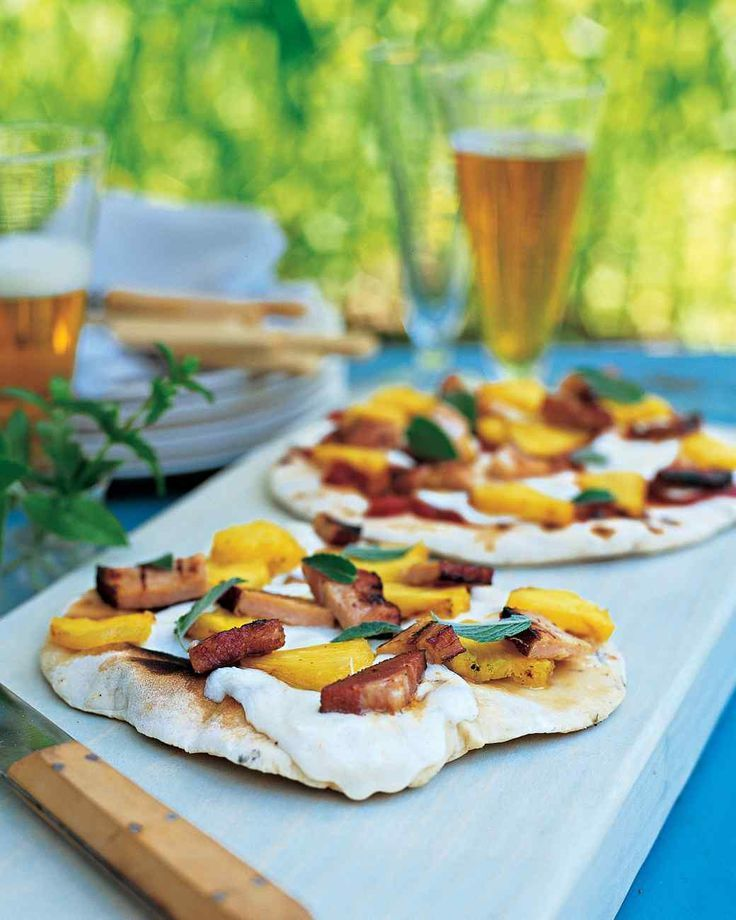 Grilled Pizza Recipes to Make This Summer | Martha Stewart Living - In our rendition of Hawaiian pizza, we swap the ham for Canadian bacon and garnish with fresh mint leaves -- yes, we like to mix things up!