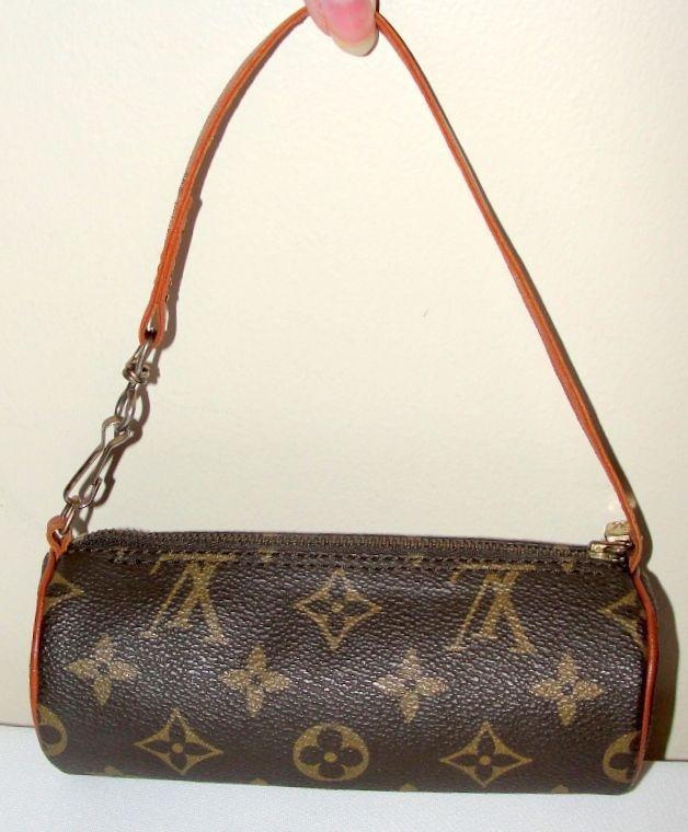 Authentic Vintage Louis Vuitton Mini Papillon Monogram Bag. So cute! It s a  mini barrel bag that measures 6L x 2 1 2H x 2 1 2W. The canvas is designed 4e4ad725d620b