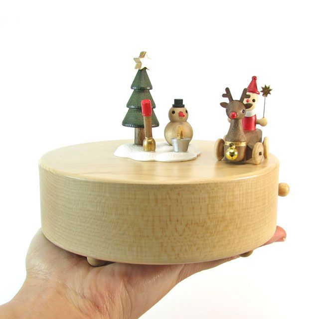 """This unique fine-wood crafted music box comes with a miniature Reindeer that circles around a Snowman and Christmas Tree with Santa in his sleigh! It moves to the tune of """"Jingle Bell Rock""""!  Thanks t"""