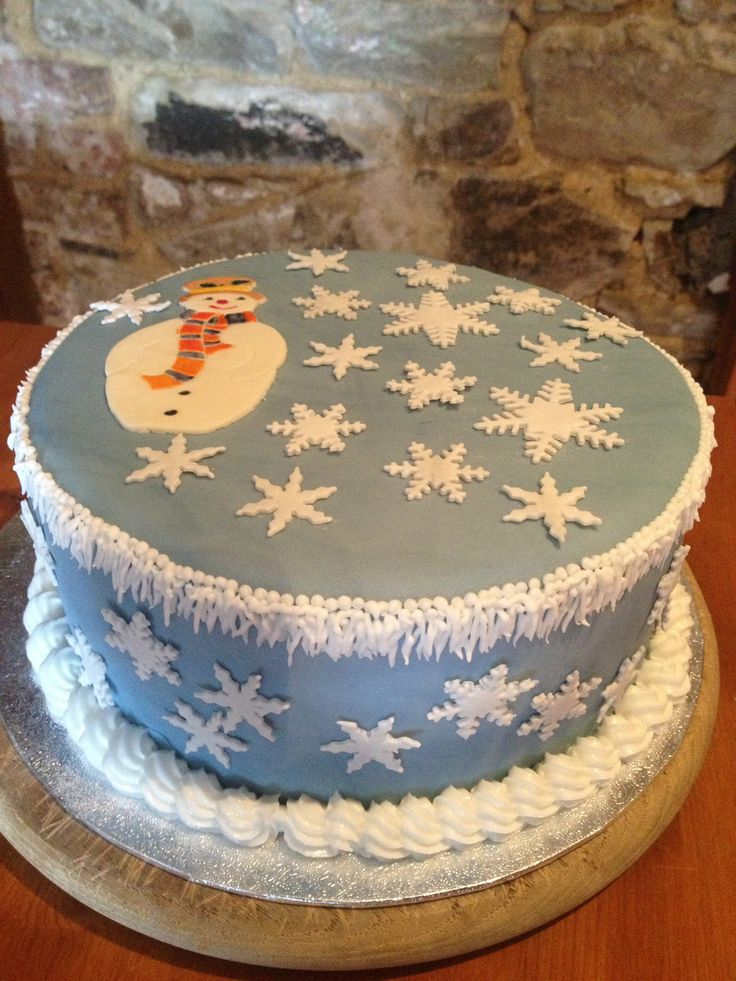 Blue Christmas cake using a patchwork cutter snowman and snowflakes