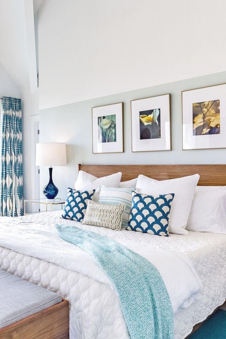 Beach house bedroom with teal accents. Half wall is Benjamin Moore's Healing Aloe. Aquamarine beach house Port Aransas TX.