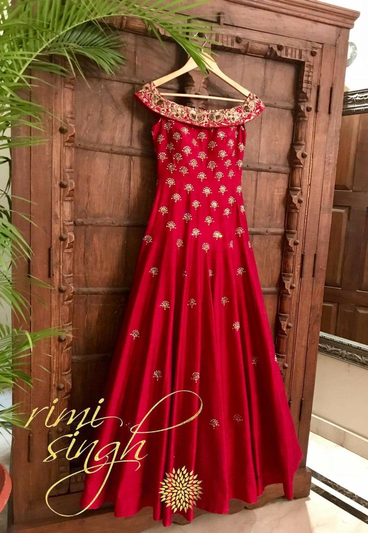 Nothing says confidence and glamour like a classic red ... Deep red, pure raw silk off shoulder, floor length gown, with zardozi and swarovski hand embroidery... Available exclusively at Rimi Singh Studio A 999 Sushant Lok 1 Gurgaon #9818310054