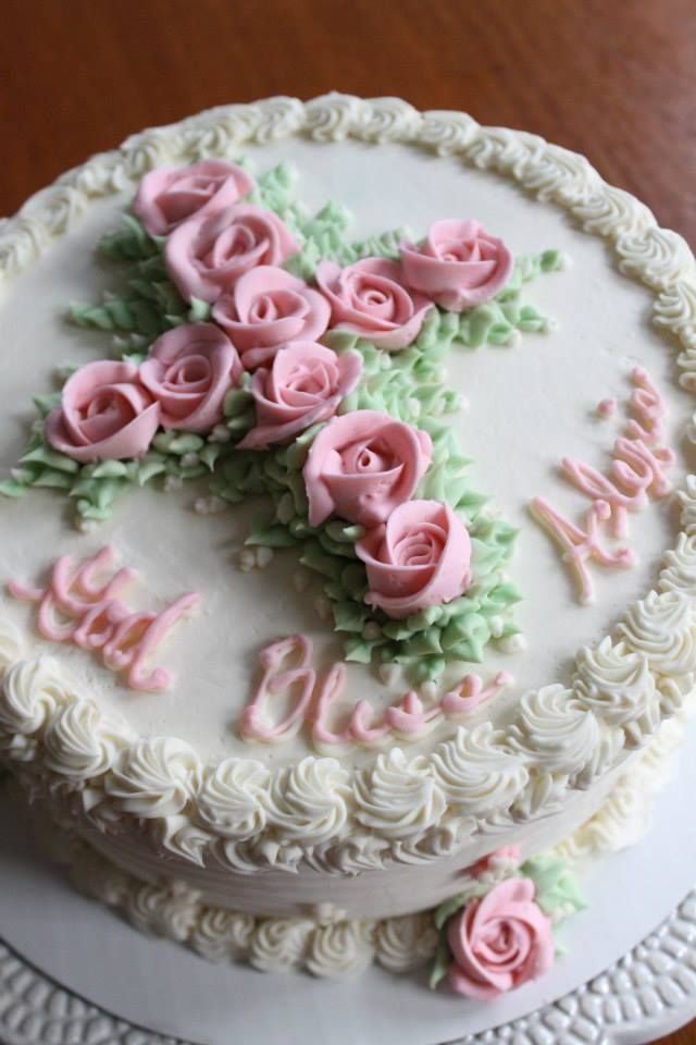 A sacrament cake - baptism.  Pink roses buttercream frosting.