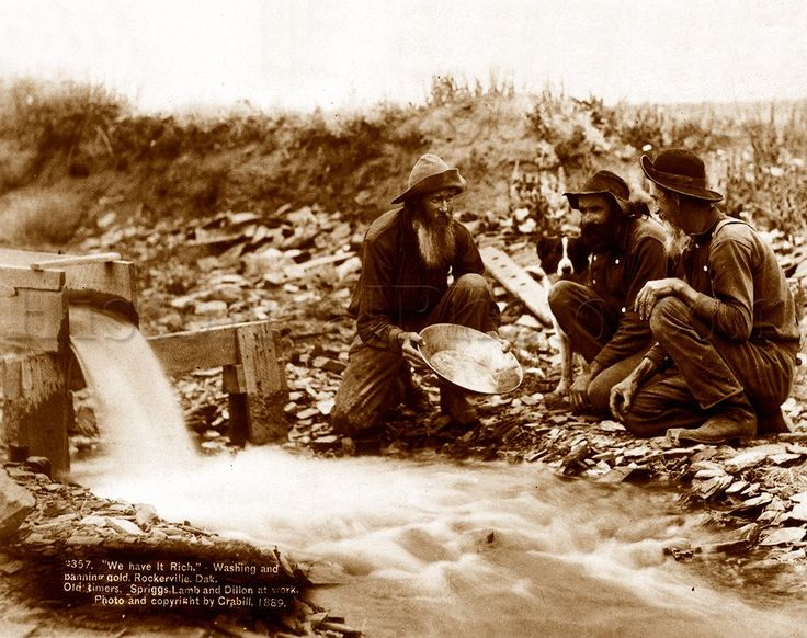 Old-timers Spriggs, Lamb, and Dillon are shown here panning for gold in Rockerville, Dakota Territory. The Black Hills area was a major hub of western mining. B