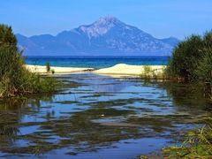 Sarti Beach view on holy Mount Athos. Greece, Chalkidiki, Sithonia.