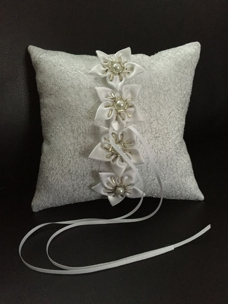 White and silver wedding ring pillow https://www.etsy.com/listing/288640263/white-and-silver-wedding-ring-pillow