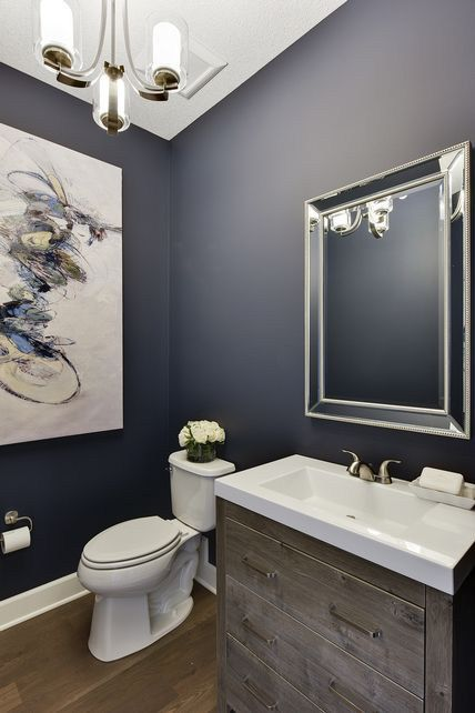 Powder room - bathroom with navy blue walls, white trim - light wood.  Great blog post with navy blue paint colors.   (Wooddale Builders - Spacecrafting Photography)