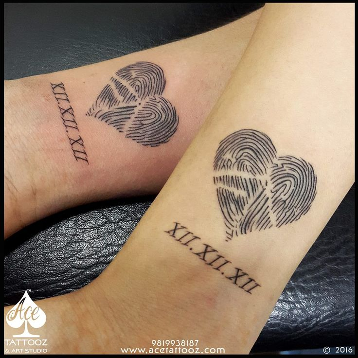 The Power of Love bonds two souls into one! Such is this couple who got each others thumbprint tattooed incorporated in a heart with the date when they first met eachother. Simple yet Powerful  Design. www.acetattooz.com Artist:- #AdityaPanchu Size:- 2' x 2' approx placement:- #Wrist #acetattooz #lovetatto #coupletattoo #hearttattoo #tattooparlour Instagram:www.instagram.com/acetattooz/ Facebook:www.facebook.com/AceTattooz/
