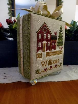 Little House Needleworks- X-stitch finished into a cube-- no sewing or gluing required! (it uses styrofoam with fabric and ribbon to cover the unfinished cut edges, with a pin to hold the edges / bow in place. Then, beads as feet so it will stand- clever!