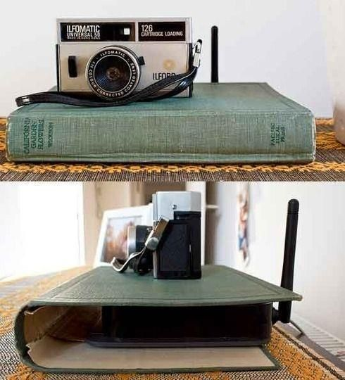 """Use an old hard-back """"shell"""" to conceal the wireless router.  (via justimagine)"""