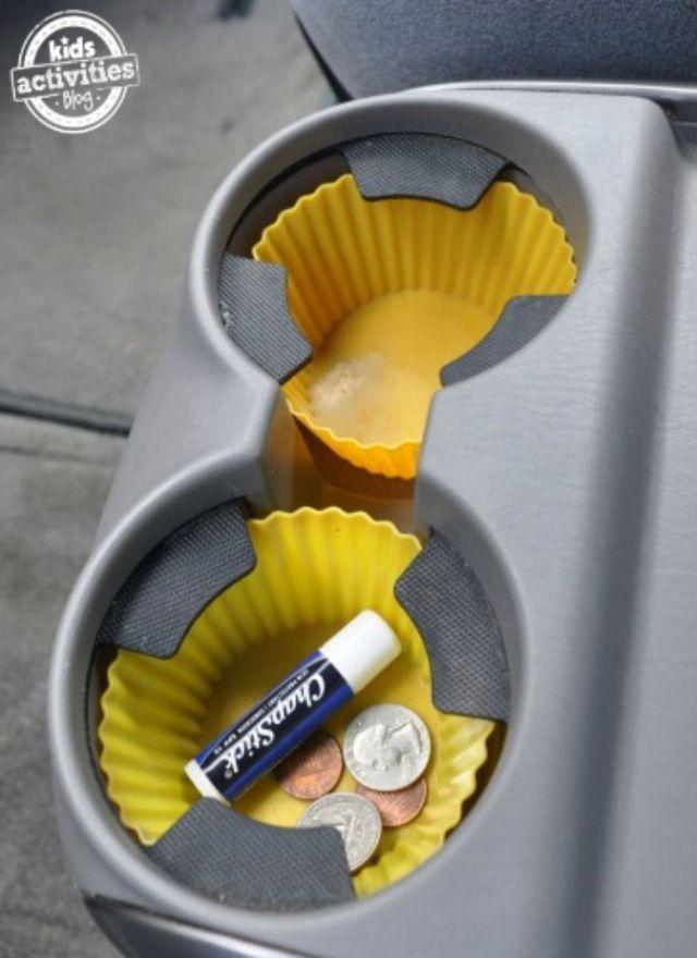 26 Genius Road Trip Hacks Seen on Pinterest: Use cupcake liners to keep car cup holders clean