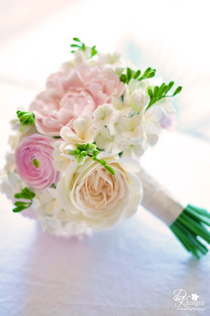 DK Designs - blush pink/ivory/white bouquet filled with peonies, ranunculus, hydrangeas, freesia and David Austin roses.