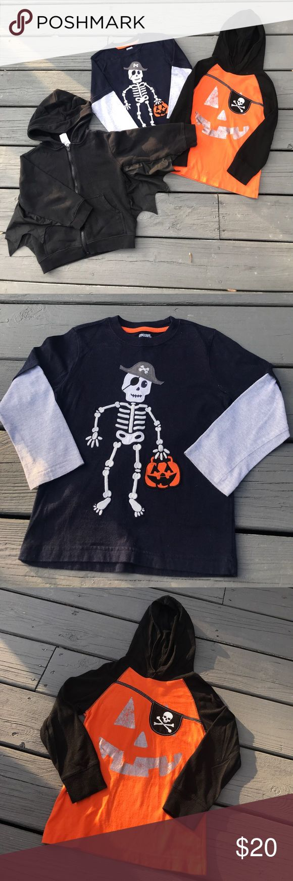 Gymboree Halloween Bundle 3 great Gymboree Halloween tops in one listing. Black batwing zip up hoodie w/ ears on hoodie. 88% Cotton/12% polyester. Navy & grey long sleeved skeleton embroidered tee (100% Cotton). Orange pirate jack-o-lantern Long Sleeved Hoodie tee (100% Cotton). All 3 in great condition - only worn a handful of times during the Halloween season last year! Hoodie is a 4T and Tees are both a size 4. Gymboree Shirts & Tops Tees - Long Sleeve