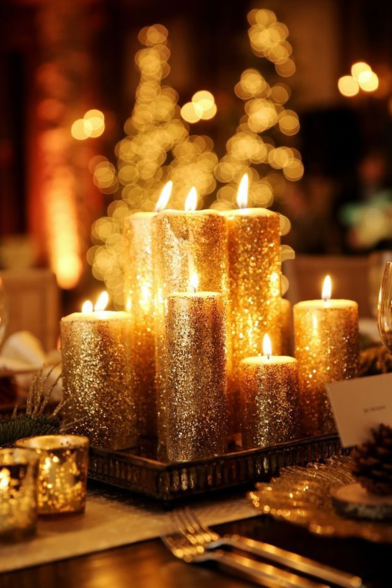 gold glitter candles wedding centerpiece / http://www.deerpearlflowers.com/wedding-ideas-using-candles/