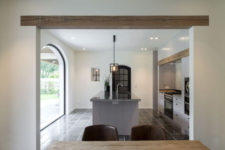 really like the use of the wooden bean on entry way and cooker hood. I told buider to use brick for half way up pantry wall but he forgot! I need to bring rustic beam in somewhere but don't want a big truss as too much