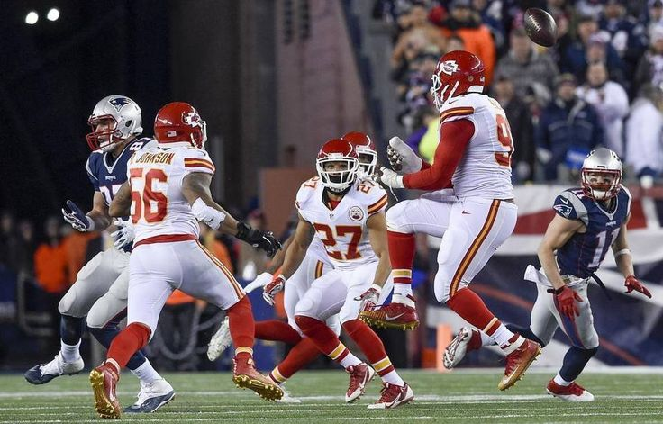 Kansas City Chiefs inside linebacker Derrick Johnson (56), Kansas City Chiefs defensive back Tyvon Branch (27) and Kansas City Chiefs outside linebacker Tamba Hali (91) were all looking for the ball as his ricocheted into the hands of New England Patriots wide receiver Julian Edelman (11) in the final moment during Saturday's Kansas City Chiefs and New England Patriots AFC Divisional round play-of at Gillette Stadium on January 16, 2016 in Foxborough, Massachusetts. New England beat Kansas…