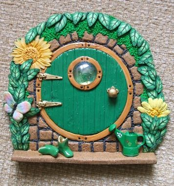 Round Green Fairy Door with Watering Can by PatsParaphernalia, via Flickr