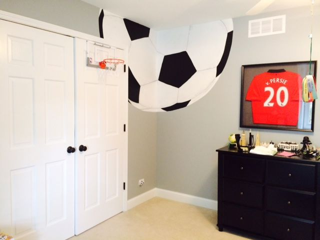 this soccer ball was painted in a corner of a 10 year old boys soccer themed room the look make it interesting