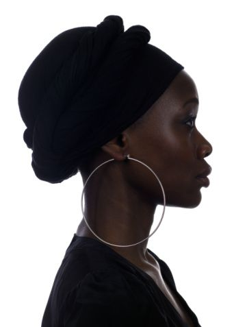 Young woman wearing large earring, close-up, profile
