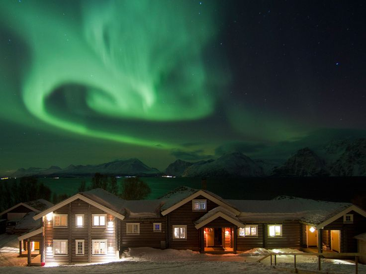 Near Tromsø, NorwayIf seeing the Northern Lights is still on your bucket list, book yourself a sojourn at the Lyngen Lodge in Norway. Wile the day away in the sauna or outdoor Jacuzzi or peruse the cozy library. Later, it's time to move into the central room of the house, where guests gather around the large open stone fireplace and gaze at one of nature's unsurpassed spectacles from behind large panoramic windows.