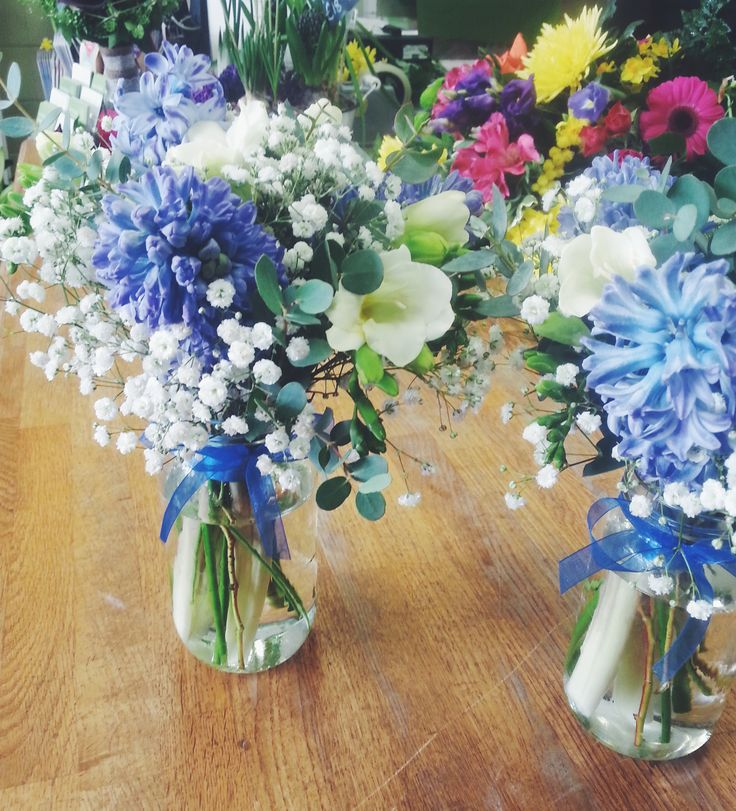 Pretty flower bottles going out to one of our corporate clients today to brighten up their tables - these are so cute! Shop flowers at: http://www.isleofwightflowers.co.uk/