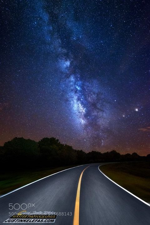 "Driving into the Milky Way by Justin Kelefas  ""Driving into the Milky Way""  This shot was taken on County Road 621 in Lake Placid Florida just South of Charlie Drive around 4:30AM as the Milky Way rose into position. When I saw the bend in the road going south I knew it could be a great alignment so I pulled over and got out of the car to see the milky way coming down into the bend of the road. The motion effect was of course added for effect in post processing. I can show you how I did this…"