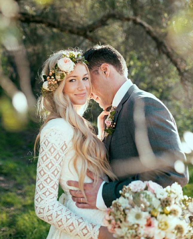 **love that flower crown!   20 Long-Sleeved Wedding Dresses via Brit + Co.