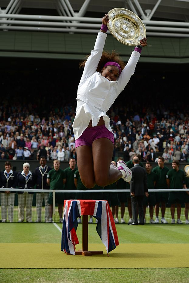 Serena Williams jumps in the air with the Venus Rosewater Dish after winning her fifth Wimbledon title. - Matthias Hangst/AELTC