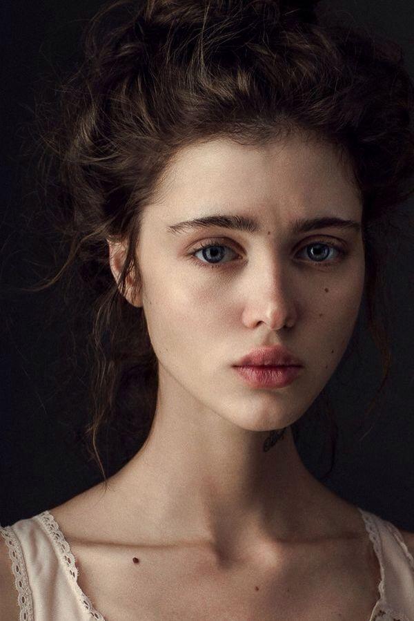 Dark brown hair and fierce blue eyes.