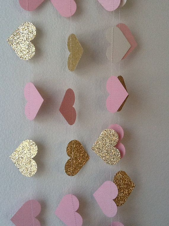 Hang our Pink and Gold Lux Heart Paper Garland for some sparkle!    Our garland has soft pink and gold tones with just the right amount of glitz.                                                                                                                                                     More