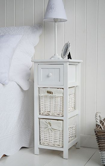 White bedside table in Bar harbor with two storage baskets and drawer. A slim bedside table for narrow spaces in the bedroom from The White Lighthouse