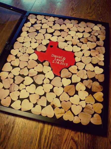 "Steer clear from the traditional guest book and use one of these fun guest  ""book"" ideas for your wedding!  1. Shadow Box of Tiny Hearts  Have your guests sign little wooden hearts and place them all in a shadow  box for you to display. Perfect idea for your Texan guests to share som"