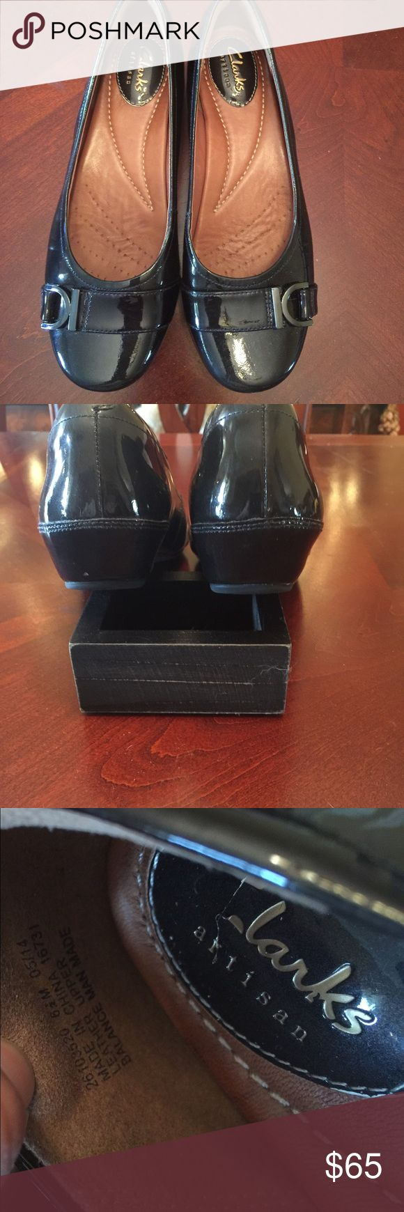 Clark Black Patent Shoes, size 6.5 Woman's leather upper ballet flat man made from Clarks®. Worn a few times. Soft cushioned soles.  One heal has a tiny knick as shown in photo. Smoke free home.  Excellent condition. Clarks Shoes Flats & Loafers