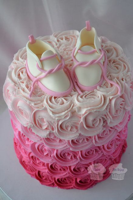Pink Ombre Rosettes with Baby Bootees  Cake by susieqhomemaker... would love this with fall colors surrounded by cupcakes, maybe a pumpkin or fall flowers on top!