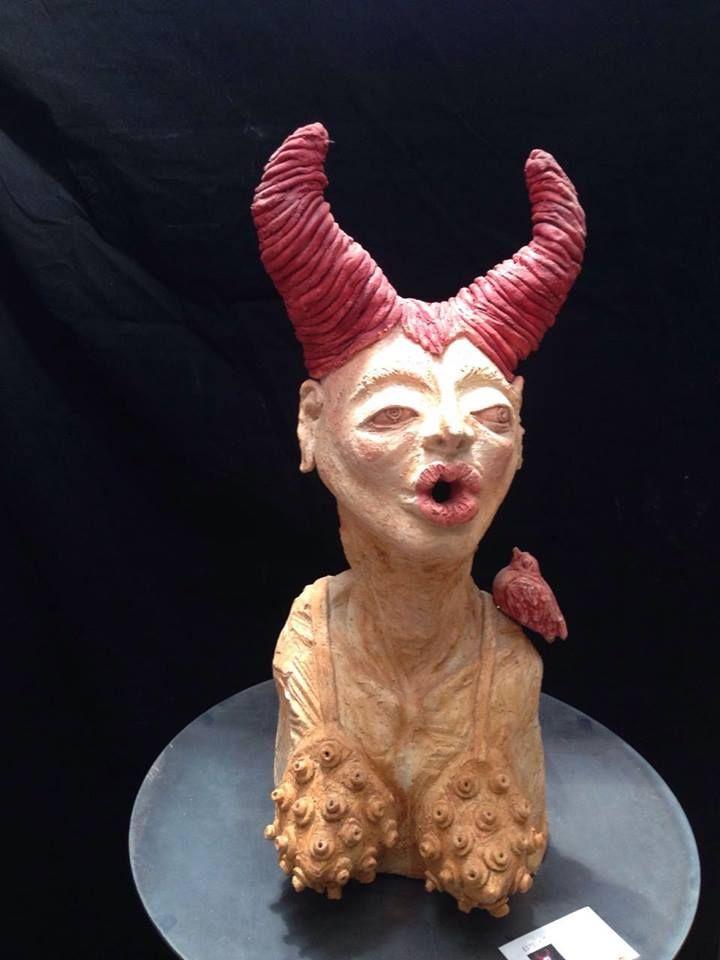 """Eufenia Corcuera.  Pieza de la colección los """"Burocratas"""".  Ceramica de alta temperatura, con engobes sobre acero."""