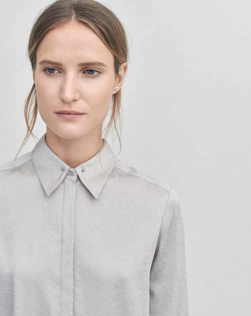 Sophisticated shirt in a fine structured silk. Contrasted by a sharp silver stud button down collar.  <br><br> - Luxe shirt<br> - Silver stud collar<br> - Silk jaquard<br>