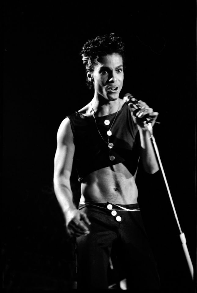 """Prince performing at Wembley Arena in 1986. Crop tops are a huge trend today, but no one rocked a crop like Prince did back in '86, as anyone who saw the """"Kiss"""" video can attest. Photo: Getty."""