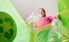 """WHAT CAN YOU DO TO MINIMAZE THE EFFECTS OF GLOBAL WARMING """"photo of girl throwing bottle in recycle bin"""""""