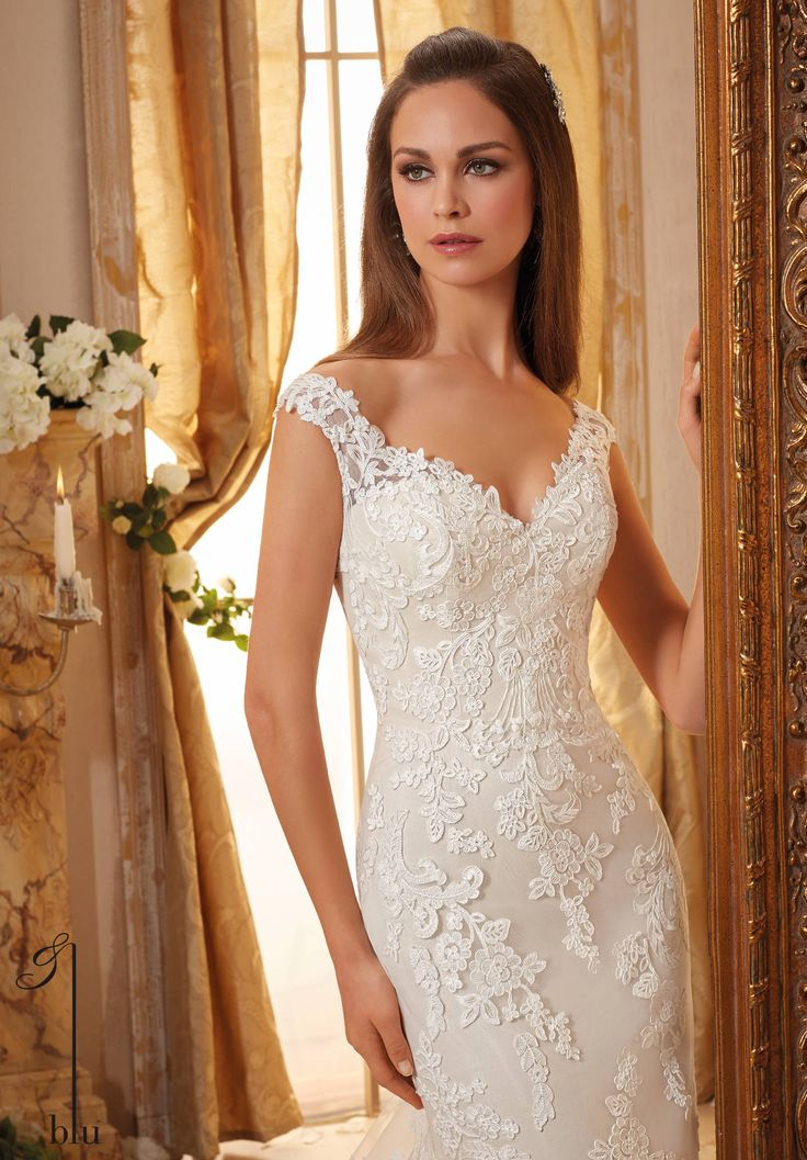 Morilee Blu collection. Style number 5471. Elegant lace cuff sleeves with sweetheart bodice design. Figure hugging mermaid gown with long soft net and lace train.