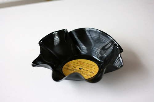 A record bowl is a classic project where you can reuse an outdated item: a vinyl record. With CDs even on their way out it's safe to say that many records can be safely molded into something new without the world losing any of its music.