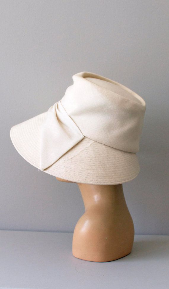 vintage 1950s St. Moritz linen hat - the simplicity of shape here in the crown and asymmetrical brim make this a VERY stylish hat!