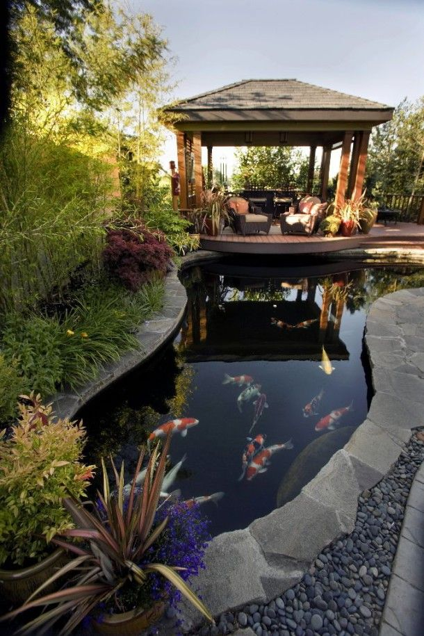 Gazebo and pond.. Beautiful outdoor space. Want gazebo to overhang pond like this with bridge