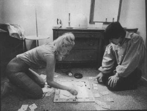 George and Jackie DeShannon playing Monopoly in a hotel room, 1964
