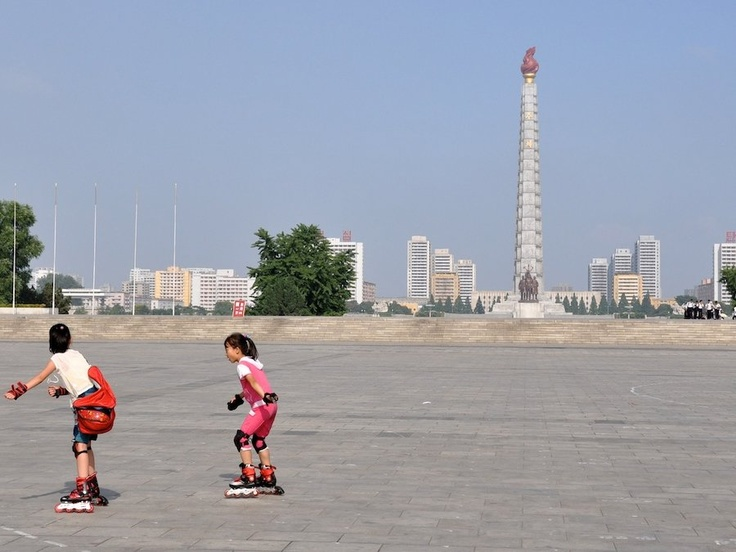 """""""Kids rollerblading in Kim Il-sung square on Sunday.""""  This picture really rocks!"""
