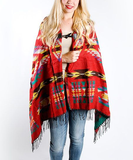 A toggle secures this boho-chic poncho styled with fringe trim and a roomy hood.