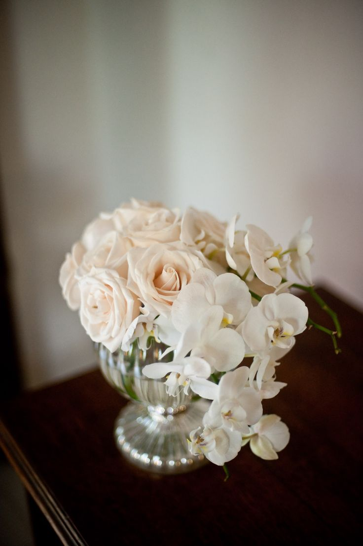 Scatter small floral arrangements of blush roses and orchids around...  Life Wonders Photography | http://www.stylemepretty.com/destination-weddings/2013/12/04/mexican-hacienda-wedding-inspiration-from-life-wonders-photography/