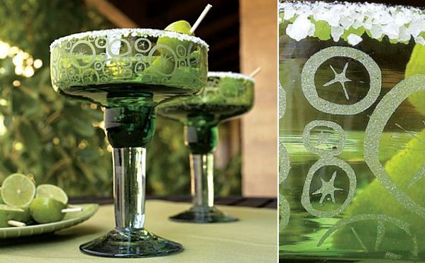 """These funky, chunky margarita glasses simply scream """"celebrate,"""" featuring straight-sided hand-blown green-tinted glass decorated with citrus slices."""