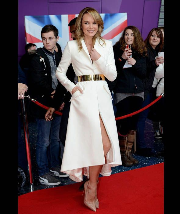 Amanda Holden flashes her leg in a white tailored coat for the Britain's Got Talent Manchester auditions